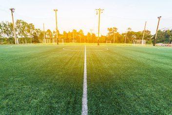 beautiful pattern of fresh green grass for football sport, football field, soccer field, team sport texture