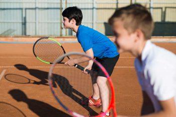 sideways-kids-playing-doubles-tennis